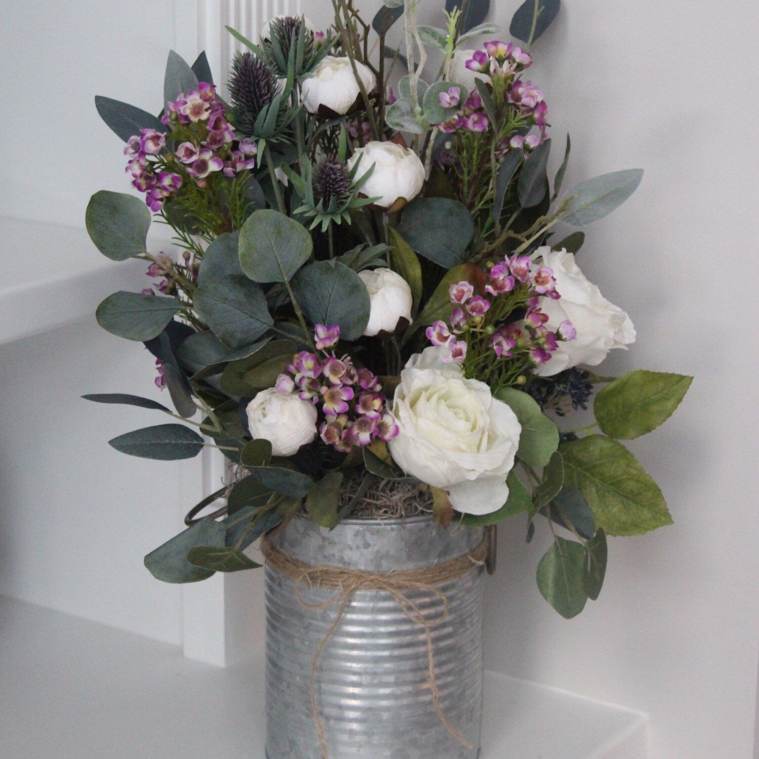 Eucalyptus mini peonies and roses make this arrangement a perfect piece for spring
