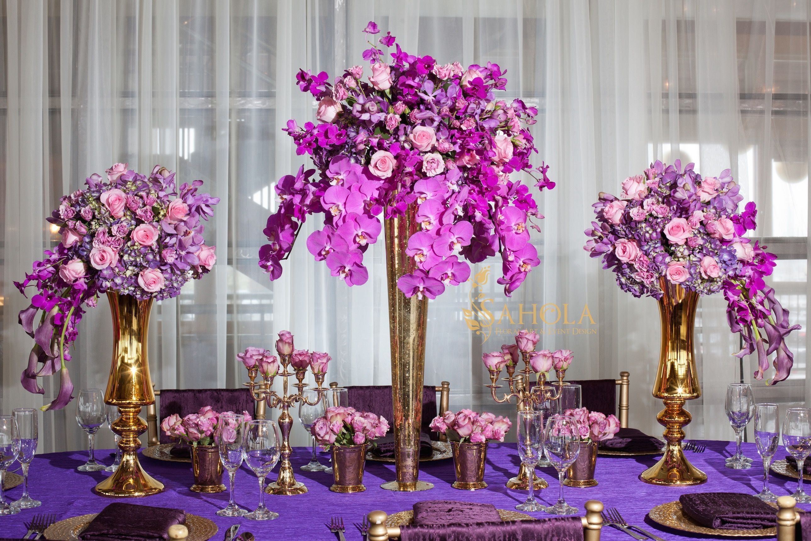 Luxury table scape in purple Event centerpiece wedding flowers purple orchids by SaholaNY