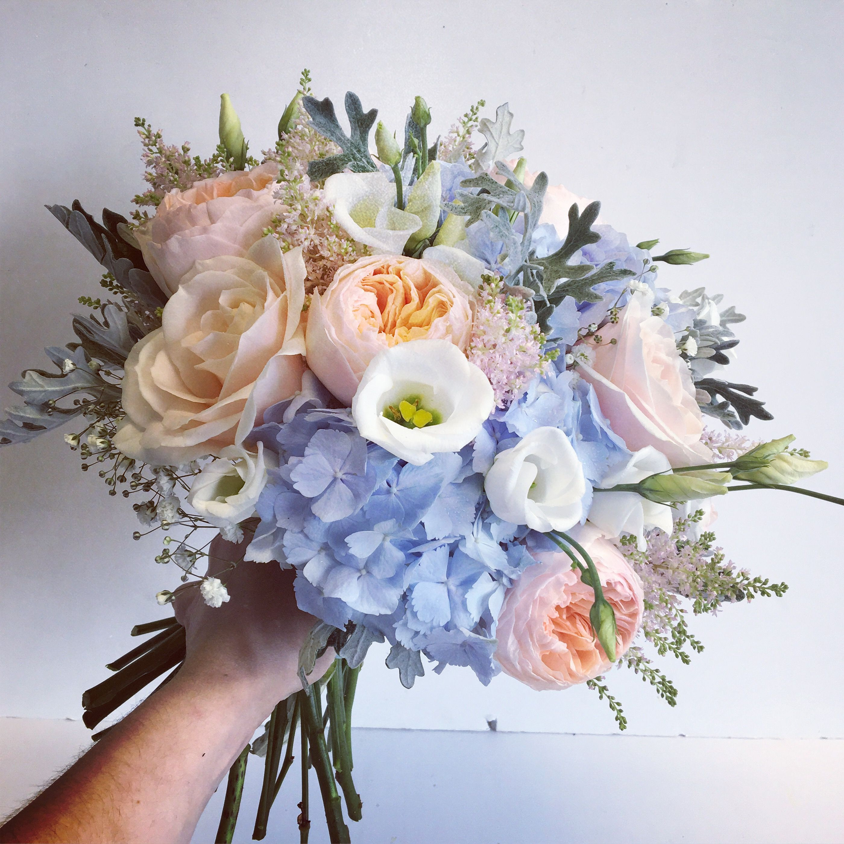 Pink peach and blue bridal bouquet including Hydrangea and Roses Designed and created by The Floral Design Boutique Scotland