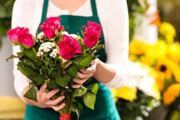 Florist hands showing red roses bouquet flowers shop market www.shutterstock.com