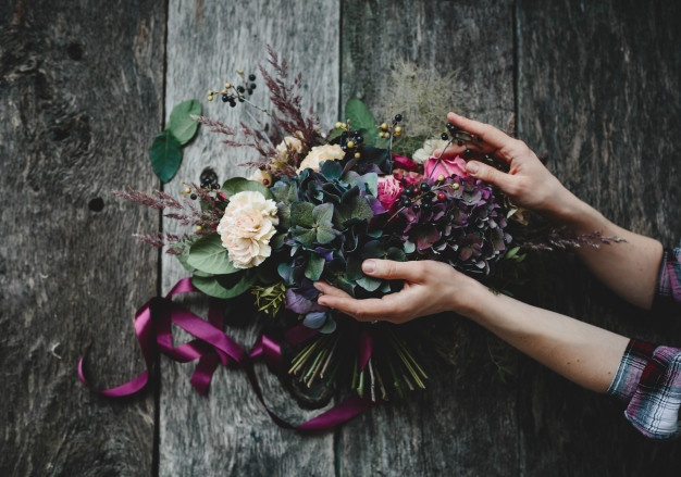 Rich-bouquet-dark-flowers-white-roses-lies-wooden-table www.freepik.com