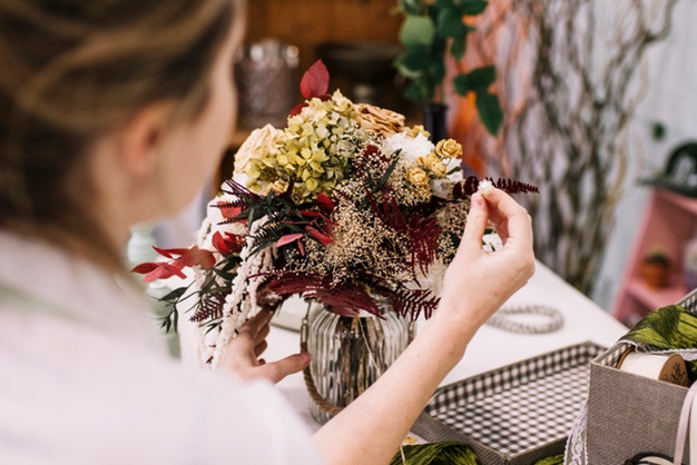Woman-making-beautiful-floral-arrangement www.freepik.com